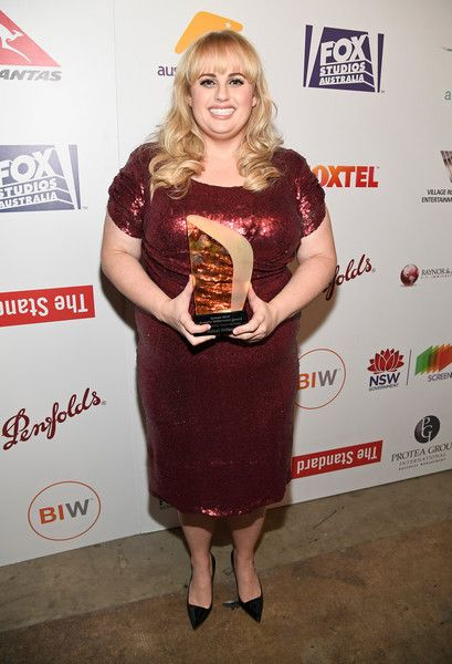 Honoree Rebel Wilson poses with the Screen NSW Kellermann Award during Australians in Film's 5th Annual Awards Gala.