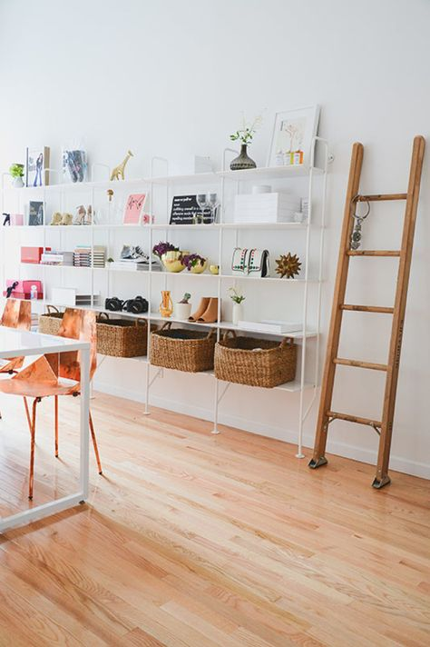 "This ladder was moved from <a href=""https://www.homepolish.com/mag/man-repeller-first-office"" target=""_blank"">the first Man Repeller office</a>. Leandra's original thoughts on the seemingly superfluous tool: ""I'd seen an image of a white room with rustic wood floors and a ladder positioned somewhere that didn't lead anywhere. It made me laugh/feel comfortable so I wanted to approximate that vibe."""