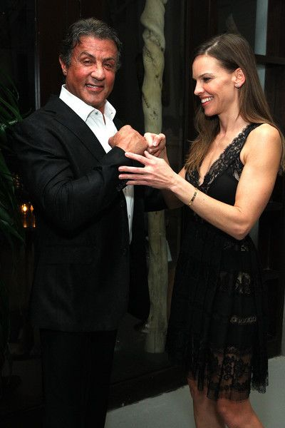 Sylvester Stallone and Hilary Swank joke around at DuJour Magazine's Jason Binn Celebrates His Annual Art Basel Miami Kick-Off Party.
