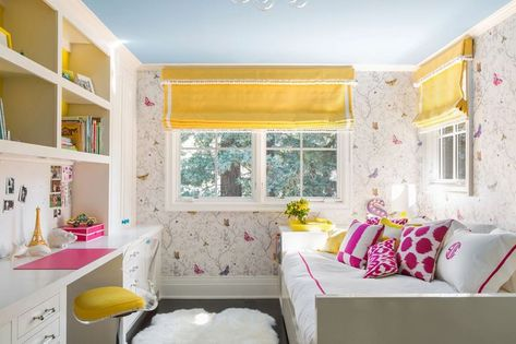 The Butterflies wallpaperby Timorous Beasties and custom yellow Roman shades in Lulu DKfabric set the tone for this vibrant space.
