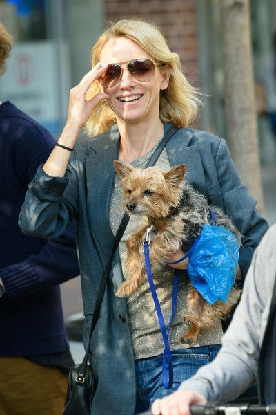 Naomi Watts goes out for a walk with her dog.