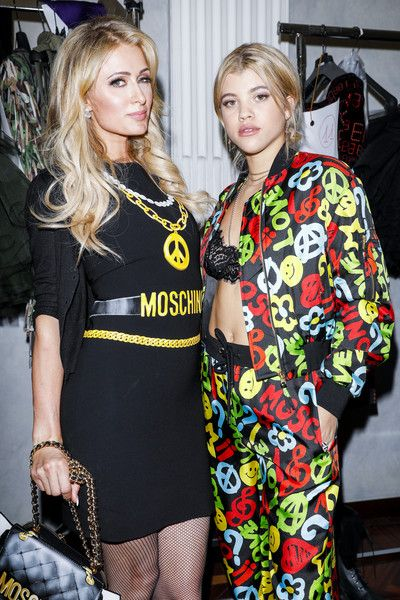 Paris Hilton and Sofia Richie are seen backstage ahead of the Moschino show during Milan Men's Fashion Week Fall/Winter 2017/18.