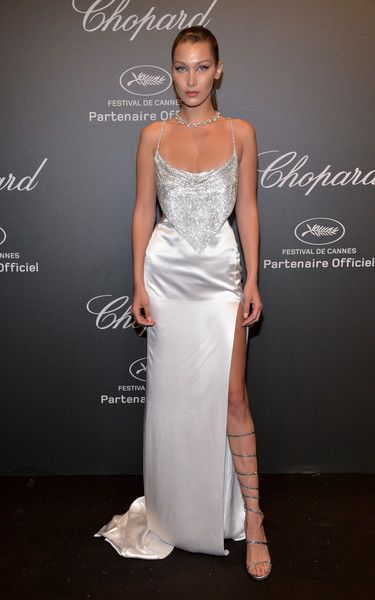 "Bella Hadid Photos Photos - Bella Hadid attends the Chopard ""SPACE Party"", hosted by Chopard's co-president Caroline Scheufele and Rihanna, at Port Canto on May 19, 2017, in Cannes, France. - Chopard Space Party - Photocall - The 70th Cannes Film Festival"