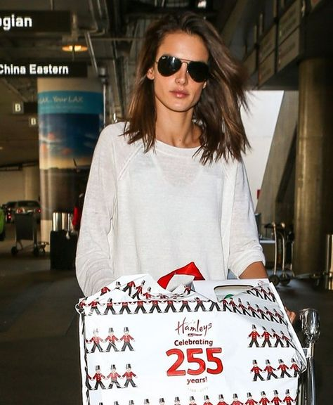 Model Alessandra Ambrosio is seen arriving on a flight at LAX airport in Los Angeles, California on November 26, 2015. Alessandra made it back just in time to celebrate Thanksgiving dinner with her family.
