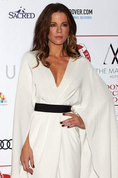 British actress Kate Beckinsale poses on the red carpet arriving to attend the London Critics' Circle Film Awards.