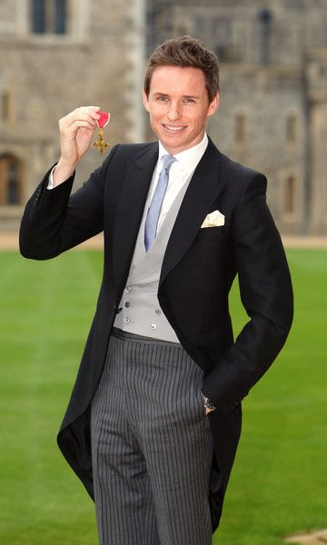Eddie Redmayne poses after he was made an OBE (Officer of the Order of the British Empire) by Queen Elizabeth II during an investiture ceremony at Windsor Castle on  December 2, 2016 in Windsor, England.