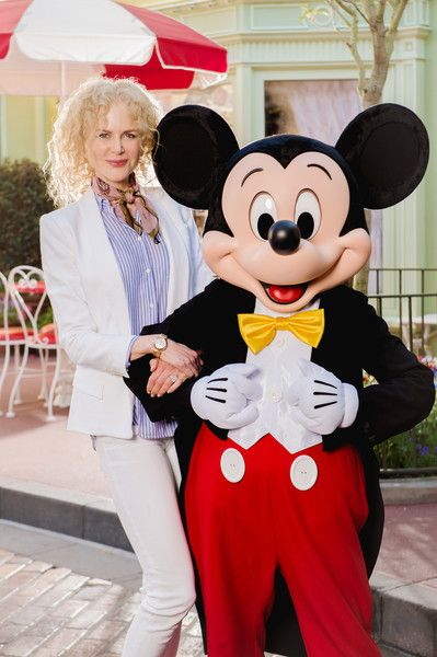 Actress Nicole Kidman poses with Mickey Mouse in Magic Kingdom Park during a visit to the Walt Disney World Resort.