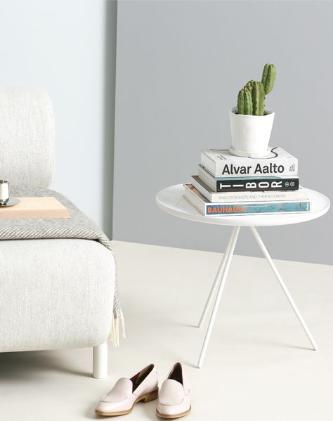 LOVE THE LITTLE SIDE TABLE WITH BOOKS AND PLANTS