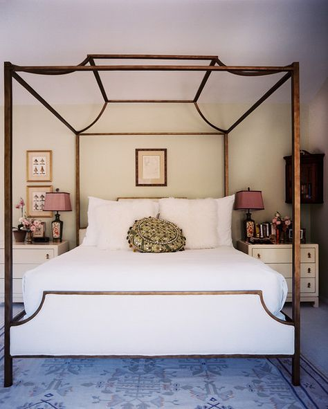 Midcentury Modern Furniture: A canopy bed with white linens.