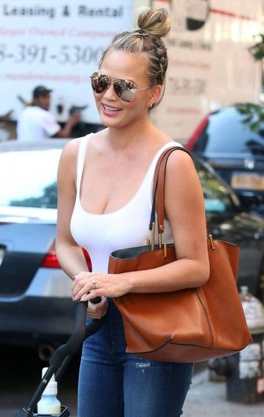 Chrissy Teigen and John Legend are spotted out and about with their daughter Luna in New York City.
