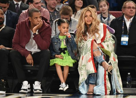 Jay Z, Blue Ivy Carter, and Beyoncé Knowles attend the 66th NBA All-Star Game.