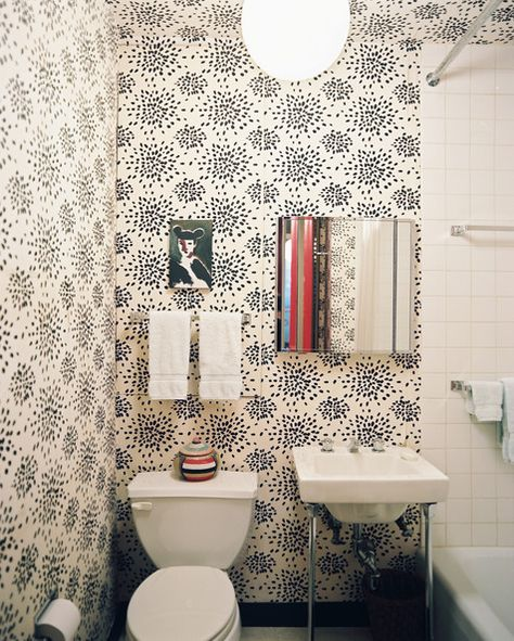 Eclectic Modern Bathroom: Black-and-white-patterned wallpaper and square white tile in a bathroom.