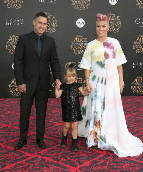 """(L-R) Motorcycle Racer Carey Hart, Willow Sage Hart and singer-songwriter P!nk attend the premiere of Disney's """"Alice Through The Looking Glass at the El Capitan Theatre on May 23, 2016 in Hollywood, California."""
