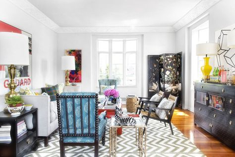 Eclectic Modern Traditional Decor: Armchairs paired with a couch, side tables, and a coffee table atop an area rug.