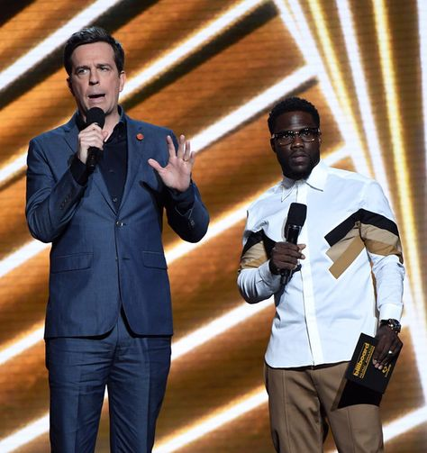 Actors Ed Helms and Kevin Hart speak onstage during the 2017 Billboard Music Awards.