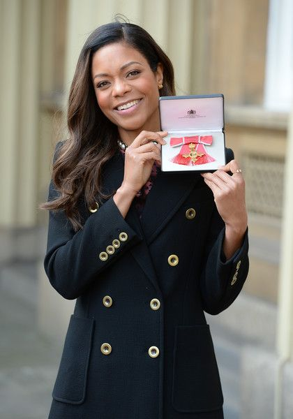 Naomie Harris after receiving her OBE medal from Queen Elizabeth II at Buckingham Palace on February 23, 2017 in London, England