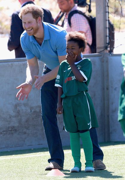 Prince Harry joins in with a Football for Hope session with Grassroots Soccer in Khayelitsha on November 30, 2015 in Cape Town, South Africa. Prince Harry is visiting South Africa as part of a Royal Tour that has included the Opening of a new Charity Centre for children in Lesotho (Sentebale's Mamohato Children's Centre) and includes stops in Durban, Cape Town, Kruger National Park and Johannesburg.