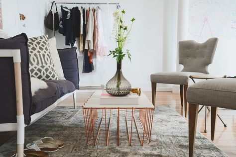 "A copper coffee table to match the copper chairs (also from <a href=""http://www.bludot.com/modern-living-room-furniture/accent-coffee-tables/scamp-large-table.html"" target=""_blank"">Blu Dot</a>)."