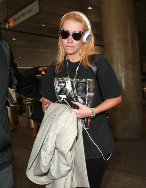 Iggy Azalea is spotted touching down at LAX.