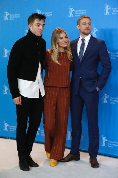 "(L-R) British actor Robert Pattinson, US actress Sienna Miller and British actor Charlie Hunnam pose for photographers during a photocall for the film ""The Lost City of Z"" presented at the Berlinale Special section of the 67th Berlinale film festival in Berlin on February 14, 2017. / AFP / Odd ANDERSEN"