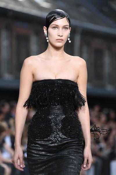 Bella Hadid walks the runway during the Givenchy Menswear Spring/Summer 2017 show.