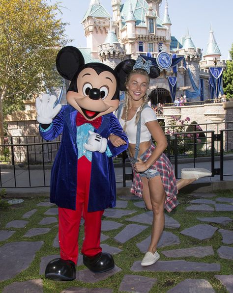 Dancer/Actress Julianne Hough visits Sleeping Beauty Castle with Mickey Mouse at Disneyland park on June 22, 2016 in Anaheim, California.