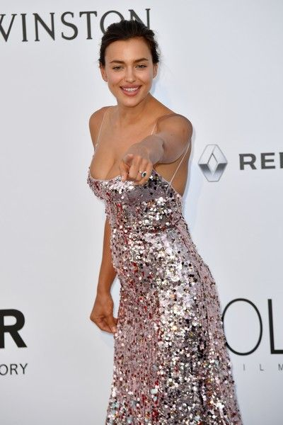 Russian model Irina Shayk poses as she arrives for amfAR's 24th Cinema Against AIDS Gala.