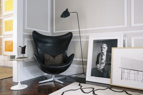 Work Space: A living room corner with a black-and-white portrait of David Hockney next to an Ed Ruscha etching.