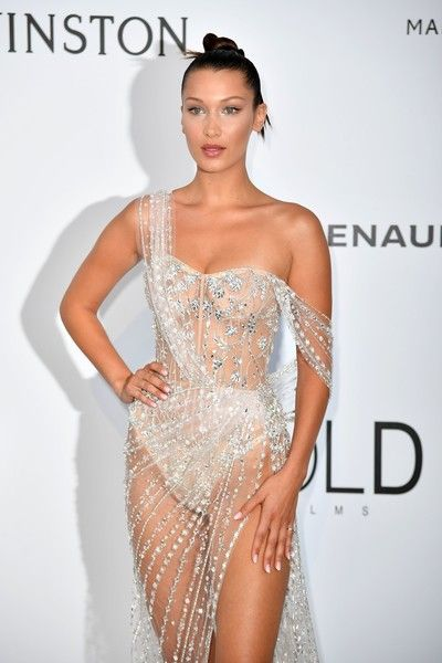 US model Bella Hadid poses as she arrives for amfAR's 24th Cinema Against AIDS Gala.