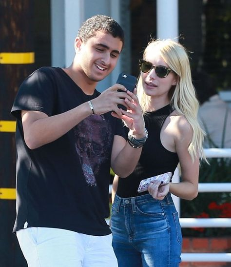 Actress Emma Roberts is spotted taking a selfie with a fan while shopping at Fred Segal in West Hollywood.