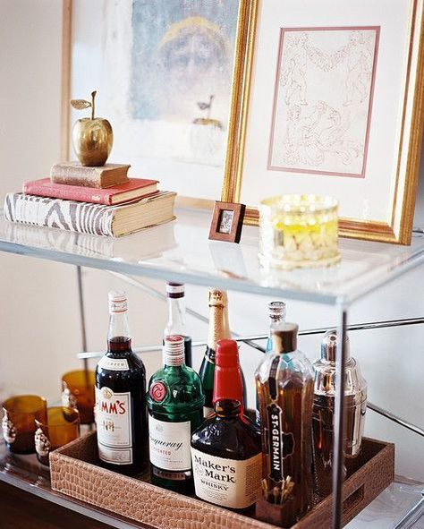 Great Bar Cart Ideas: Sometimes bottles don't necessarily deserve top billing on your table. Leave the tabletop clear for pretty curios and utilize a lower shelf for the hard stuff.