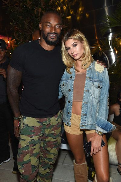Model Tyson Beckford poses with Hailey Baldwin at an event introducing Hailey Baldwin for UGG Classic Street.
