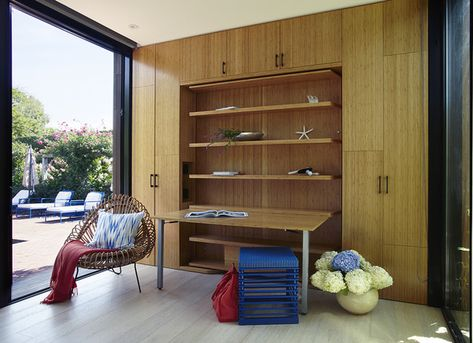 Contemporary Work Space: Modern workspace with bamboo cabinets and built-in fold out desk. .
