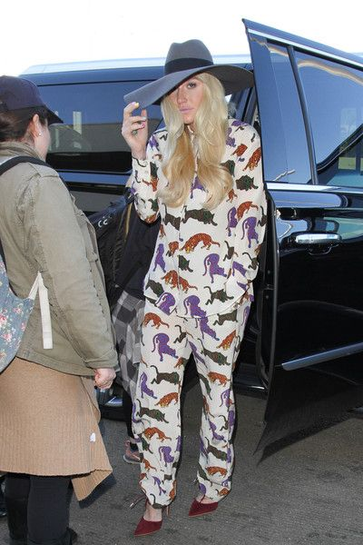 Kesha is seen arriving at LAX in a colorful jumpsuit.