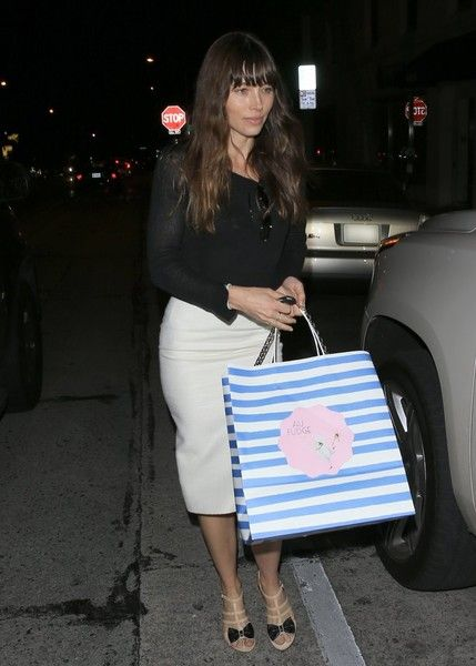 Actress Jessica Biel was seen looking super chic in a white pencil skirt as she left Au Fudge in West Hollywood, California on March 16, 2017.