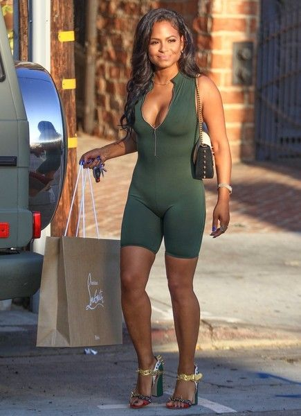 Singer/songwriter Christina Milian rocks a one-piece and studded high heels while shopping in Hollywood.