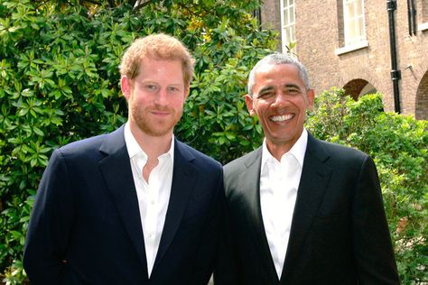 Prince Harry poses with US President Barack Obama following a meeting at Kensington Palace.