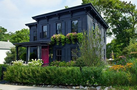 The all-black exterior of this Upstate New York Victorian hints at the unconventional design inside.