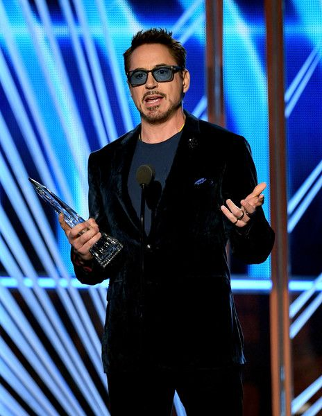 Actor Robert Downey Jr. accepts the award for Favorite Movie Actor onstage during the People's Choice Awards 2017.
