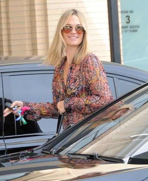 Molly Sims and a friend are spotted out shopping at Barneys New York.
