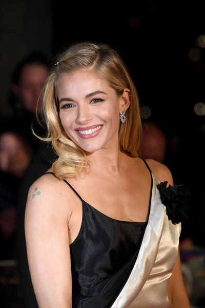 Actress Sienna Miller attends the film premiere of 'Live By Night.'