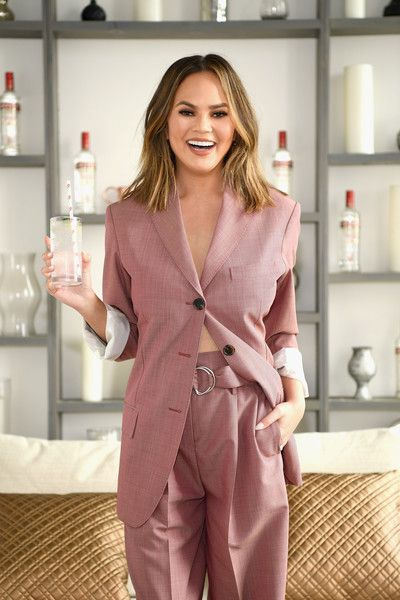 Chrissy Teigen hosts a 'Cocktails With Chrissy' event featuring Smirnoff No. 21 vodka summer cocktails in NYC.