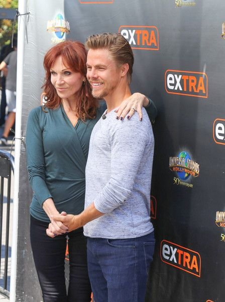 Derek Hough and Marilu Henner are seen on the set of 'Extra.'