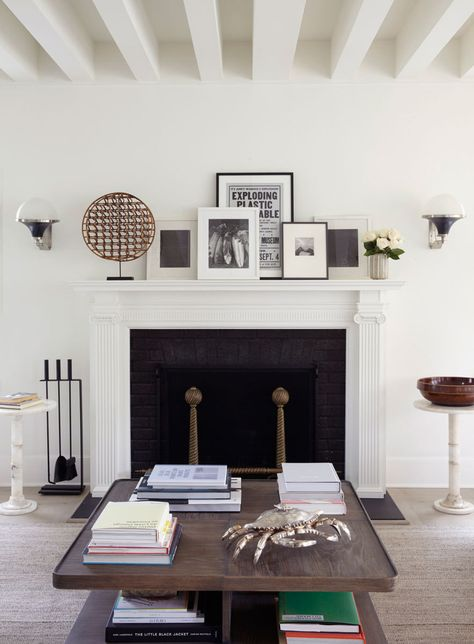 Huniford gave the existing mantel in the living room a slimmer profile to help increase the space's flow.