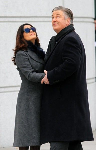 """Salma Hayek passionately kisses Alec Baldwin while filming their latest movie """"DRUNK PARENTS"""" outside a Bronx Court House on February 12th, 2016. In the scene she's escorted by a security officer where Alec Baldwin is waiting for her outside in which they hug and kiss."""