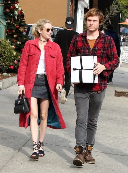 On again couple Emma Roberts and Evan Peters are all smiles while dropping off a package at a UPS Store in Los Angeles, California on December 5, 2016. The happy couple were in the holiday spirit, both wearing bright red in their outfits.