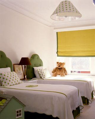 Tailored and playful.  Polka dots, green upholstered headboard, and yellow roman shade.