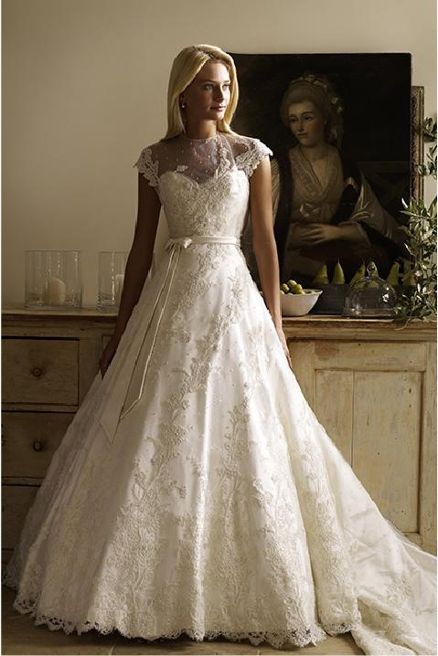 I love this dress!  Could be for my vintage or classic style wedding.