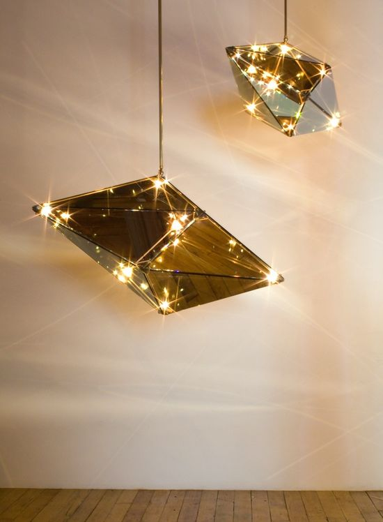 Faceted mirror chandeliers. ]