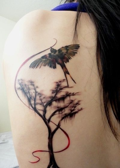 Gorgeous tree and bird tattoo